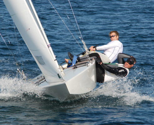Strube sailing- men leaning off side of boat