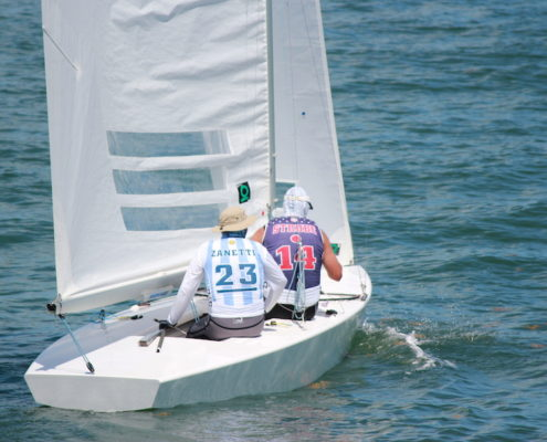 two men on sailboat in the water
