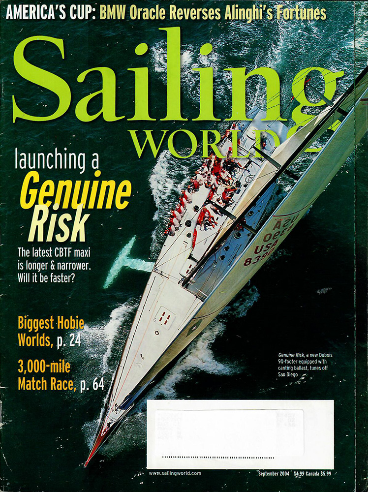 sailing world magazine cover featuring large boat in water with group of men on it